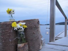Rustic decorations on the dock for the wedding ceremony. Found these tree stumps around the property.They were perfect! Diy Wedding, Wedding Ceremony, Tree Stumps, Rustic Decor, Decorations, Amazing, Modern, Plants, Beautiful
