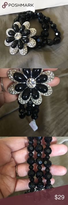 Lia Sophia stretch corsage bracelet Brand new in box never worn. Black and silver flower with black three strand stretch bracelet. Jewelry Bracelets