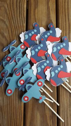 Set of airplane cupcake toppers. Each is about 3 inches and fully covered on the back so the lollipop stick does not show. They are one