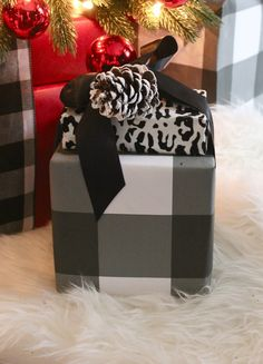 Wonderful combination of wrapping paper and ribbon. #giftwrapping http://www.aftershocksinteriordecorating.com