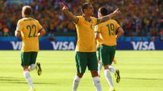 Tim Cahill of Australia celebrates after scoring