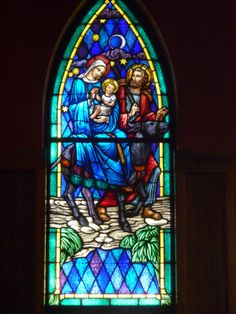 Mary and Joseph fleeing Bethlehem after an angel's warning to therm about the Christ Child/ we re adding to our stained glass windows by re working some old glass ...