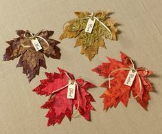 #harvest DIY party decor made with #modpodge - These scissor cut fall leaves would be so cute for a #thanksgiving tablescape. Click thru for the full how-to.