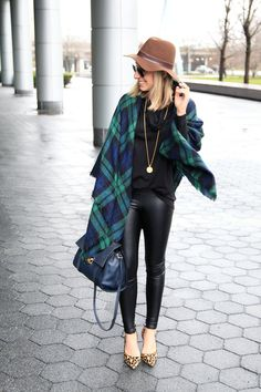 black sweater, blue/green plaid blanket scarf, gold pendant necklace, leather leggings, leopard pumps