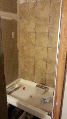 New 32x48 walk in shower. Fiberglass pan, cement backer and ceramic tile.