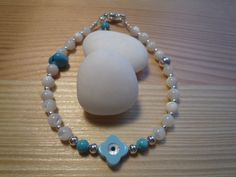 Handmade Ivory Mother or Pearls Evil Eye Protection Charm Bracelet with Turquoise Beads and Chips by urbaneprincess on Etsy