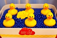 "Baby Love Baby Shower {Operation Shower} — Celebrations at Home. Chocolate Ducks from Big Lots $1each, ""floating"" on blue candies"