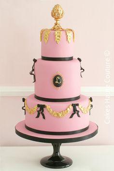 black, pink, and gold wedding cake