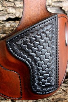 This Tin Badge Leather offering is a holster designed to fit a Smith and Wesson M & P style weapon. It has been molded to fit your weapon like a glove for a smooth draw yet sturdy enough for security and long wear. The heavy 8/9 ounce Hermann Oak leather has been dyed in a professional saddle tan color that deeply penetrates the leather and then finished with Resolene for weather resistance.    What makes this holster become noticed is the full reinforcement patch stamped in a tri ba...