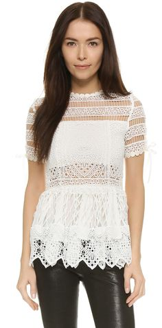 Super cute white lace top with sheer panels. Alexis Juliana Crochet Top