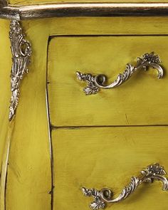 details of the gorgeous hand-crafted Louis XV style bombe chest with lightly distressed lacquered yellow finish and heavily antiqued silver hardware