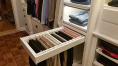 Custom Walk-in Closet, slanted ceilings...pull-out pants rack.