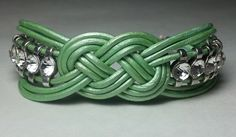 Leather knot bracelet with rhinestones in sea foam green, made by Dizzy Bees. Find Dizzy Bees on Facebook.