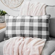 A simple buffalo check pillow is the perfect way to transition your home from summer to fall.