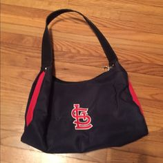 ❤️⚾️STL Purse Never used. STL Cardinals purse. Small and great for ball games! Authentic MLB Merchandise! Backside has a zip pouch. Never used! Bags Shoulder Bags