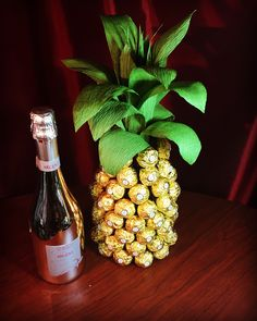 Pineapple! Made with a bottle of wine covered with Ferrero Rocher candy!