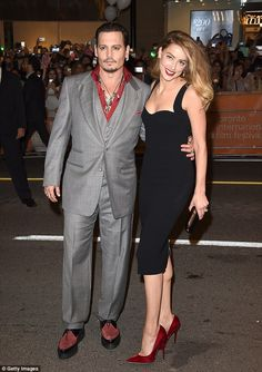 Drunk on love: Johnny Depp and Amber Heard at the 2015 Toronto Film Festival. It was reported that the actor surprised his girlfriend with a replica of the bar from the The Rum Diaries  on his  Bahamas property
