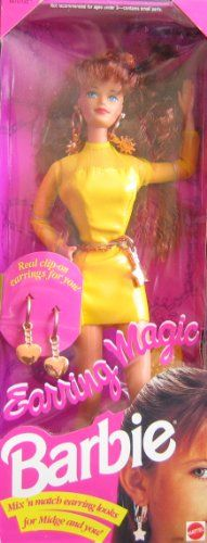 """Barbie Earring Magic MIDGE Doll w Mix 'n Match Earring Looks! (1992). Earring Magic Midge Doll is a 1992 Mattel production. Includes: Midge Doll approx. 11.5"""" tall w/long reddish hair & blue eyes. Doll wears a pair of copper color dangly Earrings, a copper tone Finger Ring, a long sleeve yellow faux """"leather"""" Dress w/copper color chain Belt w/2 copper tone metal Stars; Comes w/a yellow Hair Brush, a pair of yellow Shoes, & a pair of copper tone Heard Shape dangly Earrings for YOU & Midge…"""