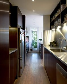 """The kitchen is tucked behind the staircase. Nayana and Mark wanted its """"working parts"""" to be hidden"""