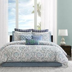 Add sophisticated coastal style to your home with the Kamala Comforter Set. The king comforter set features an abstract varied blue medallion print on an ivory background.