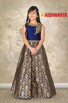 This festive season dress up your princess in this royal designer gown! Buy Kids Gown online - http://www.aishwaryadesignstudio.com/classic-blue-gold-brocade-party-gown