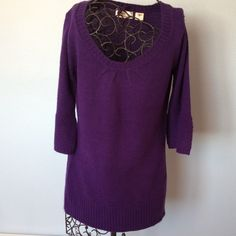 Purple sweater Three quarter length sleeves with wide band of different stitch at sleeve edge. Scoop neck with small gathers on front   Purple in color. Long length to the sweater.  Good condition. Samantha  Stuart Sweaters Crew & Scoop Necks