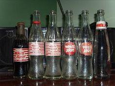 Asian Drinking Multiple Bottles