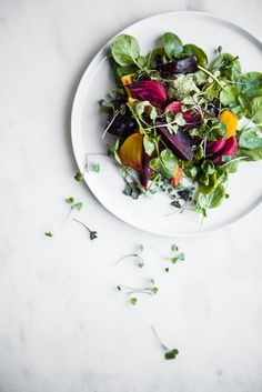 This salad with a goat cheese green goddess dressing, packed it with herbs, and plenty of garlic is a delicious way to dress up beets in the winter.