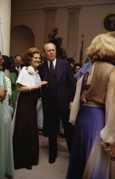 President Gerald Ford and First Lady Betty Ford pause on the dance floor at a White House state dinner in honor of Egyptian President and Mrs. Anwar Sadat (1975).