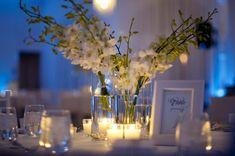simple-wedding-reception-centerpieces-ivory-flowers-blue-lighting.original | I do Ghana