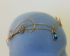 This Is a hand made sterling silver plated circlet with a genuine rainbow moonstone to the back is 2 loops so it can be kept in place with ribbon