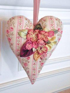 Love  Hearts,    this one is embellished with ribbon  applique.   Just  beautiful.
