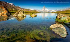 Lake Stellisee, the vortex - Lake Stellisee with the Matterhorn massif. Water vegetation in motion. Swiss Alps. ©www.albertoperer.com