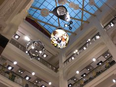 Ceiling hanging tension fabric system light boxes in department store #lightbox #retail #featurelighting