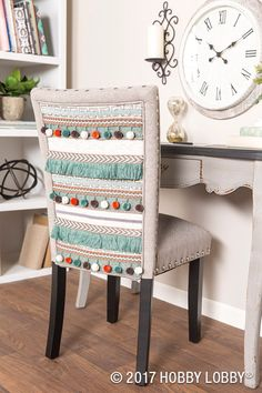 Add basic trims to bland furniture for an unexpected pop of texture and color!  Stitch trims to muslin fabric, and staple the muslin to a chair back. TIP: For larger surfaces, go for a repeating pattern—it's easier on the eyes.