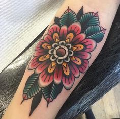 Beautiful geo zinnia flower tattoo by Jacob Cross. #sunsettattoonz www.sunsettattoo.co.nz