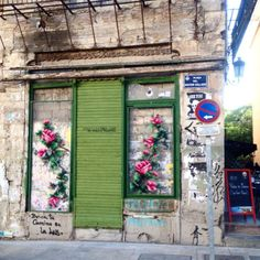 Cross Stitch Floral Embroidery Installations Take Up Residence In Neighbourhoods  Artist and set designer Raquel Rodrigo (Spain) adorns dilapidated buildings with bright floral cross stitched street installations.