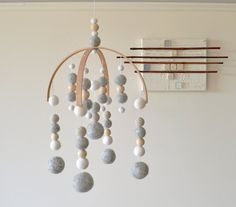 Stunning handmade mobiles for your little ones nursery.  These mobiles are made from: - Felt balls hand made in Nepal - FSC certified Wooden beads - Crocheted wooden beads - 100% Bamboo - String  Approx: 26cm wide, 35cm in length  ✖️Mobiles take between 2-3 weeks✖️  Colours and design can be custom made to suit any style of room. Colours may vary due to the grain of the wood and photo. Please note these mobiles are for decor they are not a toy, mobiles should be kept out of reach of…