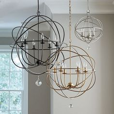 This impressive chandelier features an openwork sphere of hand-wrought iron surrounding six upright globe lights to illuminate your space.
