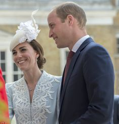 William and Kate were all smiles as they arrived at a reception at London's Guildhall...