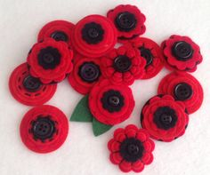 Set of 3 Handmade RED POPPY felt & button embellishments Are made with a thought of Remembrance Day.  Will make a very stylish accessory or embellishment.  Embellishments in this listing are made with quality thick crafting felt in two shades of Red and Black. Each pack contains x3 gorgeous felt flowers chosen at random by me. At least one in a set will have a stitching on it.   These are perfect for brooches, clippies, embellishments, hair pieces, bunting, card making, scrapbooking uses are…