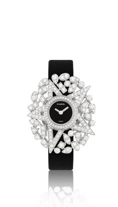#Chanel white gold, diamond watch with black satin band available at #Mayors.