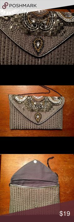 Embellished Clutch Purse with Chain. Beautiful embellished clutch with strap. Large clutch that measures about 12 inches long and 7 inches tall. It works perfect for cocktail parties and formal events. Bags Clutches & Wristlets