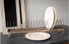 This wire plate rack is a plate rack that looks great and is super functional. Use this wire plate rack to display your favorite vintage plates or dry your every day plates. For more visit, www.decorsteals.com OR www.facebook.com/decorsteals  $39.95