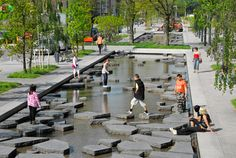 Pool-sized water feature with concrete blocks that people can step on