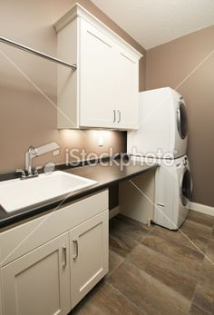 New House Laundry Room with Stacked Washer and Dryer Royalty Free Stock Photo
