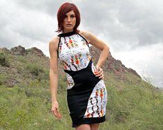https://www.cityblis.com/7077/item/17583  CNFSS1.1 - $125 by VSLZ Fashun Group  Performance knit printed dress with denim detail.