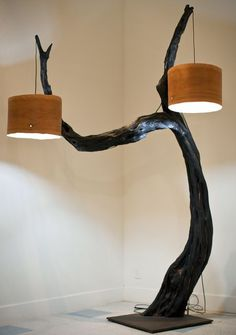 Youre going to need space in your living room, but this lamp made from a tree should seduce your guests... Two lampshades and a solid metal base.   Huge Floor Lamp with Tree Base source #Concept #Diylighting #Floorlamp #Handmadelighting #Hugelighting #Lamp #Lighting #Lightingdesign #Metallic #Recycle #Woodworking