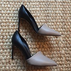 Vince Claire pumps Vince Claire pumps in black and grey. New Purchased from TJ Max and have not worn but they have some wearing on them As seen in pics. Gorgeous shoe, Unfortunately I think they are too small for me as I really am a 10. Price firm, these are a steal as they retail for $375 Vince Shoes Heels