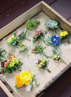 Mismatched boutonnieres is a trend that will spice up your day! Let everyone's personality shine and give them a bud to reflect it #Cedarwoodweddings African Artful Wedding at Historic Cedarwood | Cedarwood Weddings
